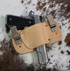 Holster will hold sub-compact, compact to full size and 1911 style pistols Same holster works for right or left hand draw Leather Holster will break into your firearm Securely holds your weapon in pla