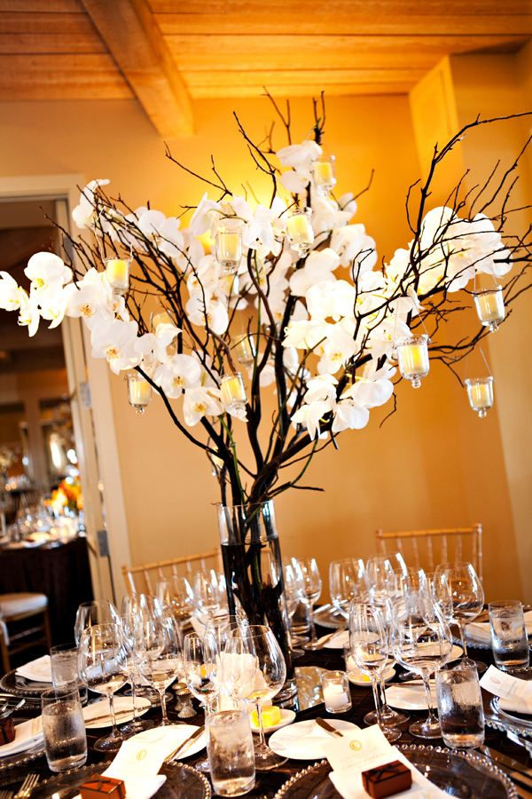 Branches centerpiece with orchids