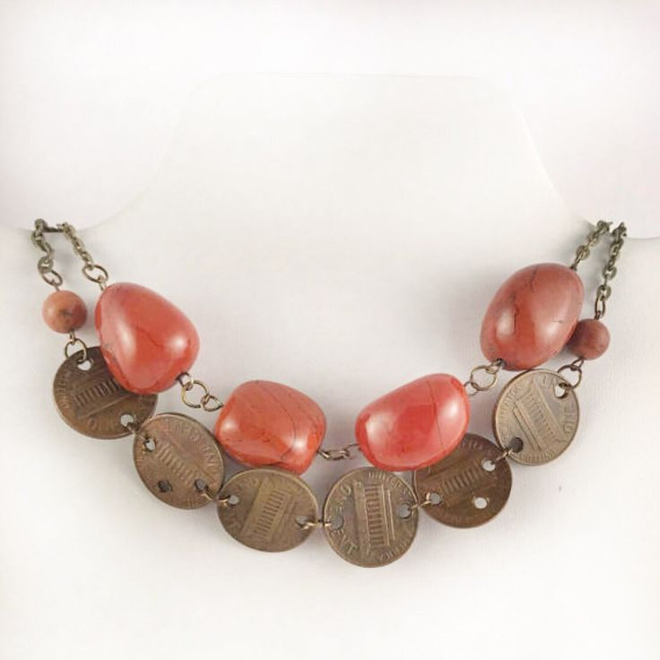 Pennies for your thoughts dance along an antique bronze chain contained with sandstone beads keeping them in line. The jasper strand measures approximately 14 inches while the penny strand measure approximately 16 inches.