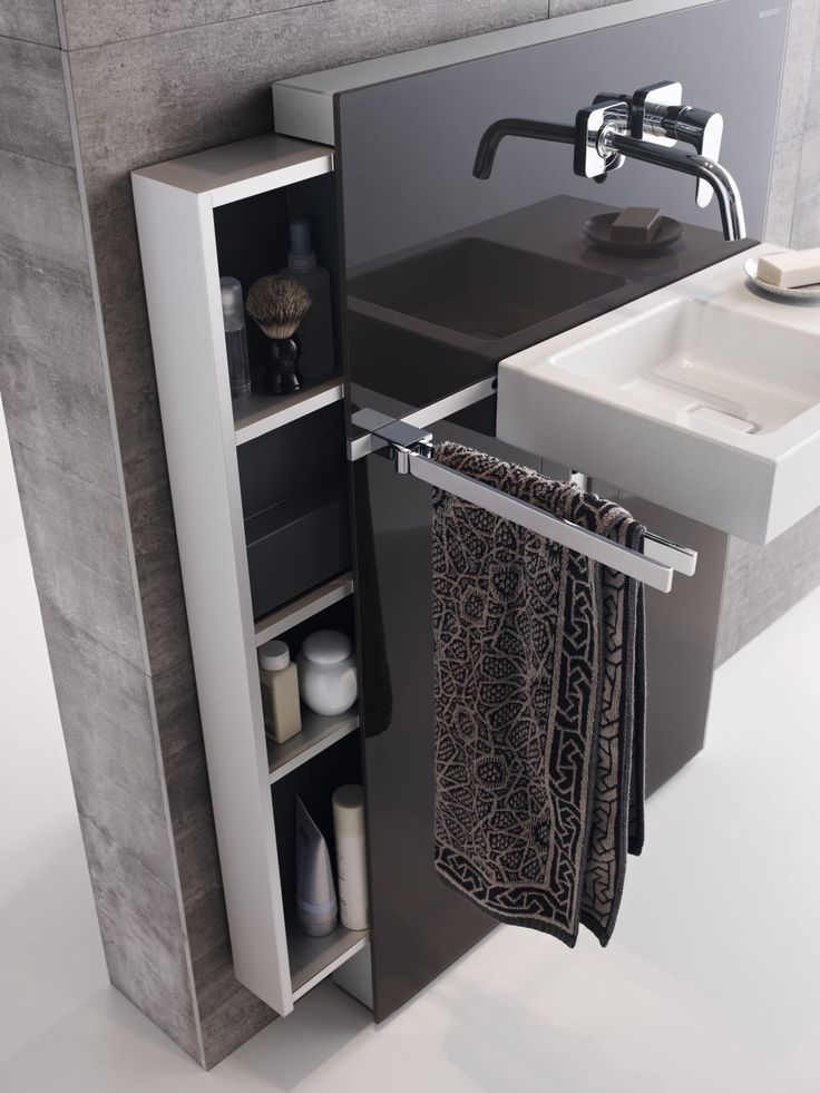 Geberit Monolith wastafelmodule, kleur Umbra, met opbergkast en handdoekhouder.