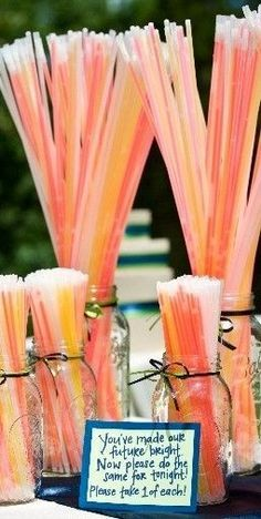 Glow sticks are a great idea for an outside summer wedding! You can choose the color sparkles and it's cheap!!