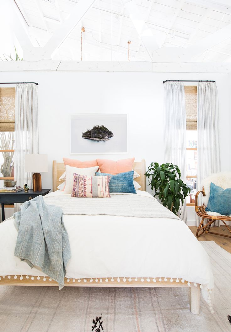 Peach pillows in a bedroom via Amber Interiors