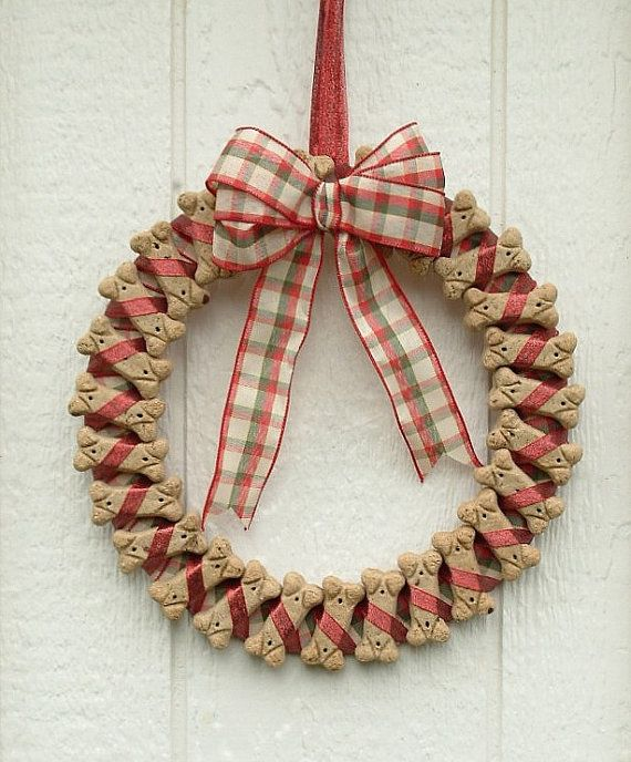 Cute idea to decorate the pet lovers home or to give as a gift to your favorite dog walker, vet, or dog sitter. DIY doggie bisquit Christmas wreath. :)  Just make sure to keep out of doggy's reach so they don't eat the glue or ribbon!