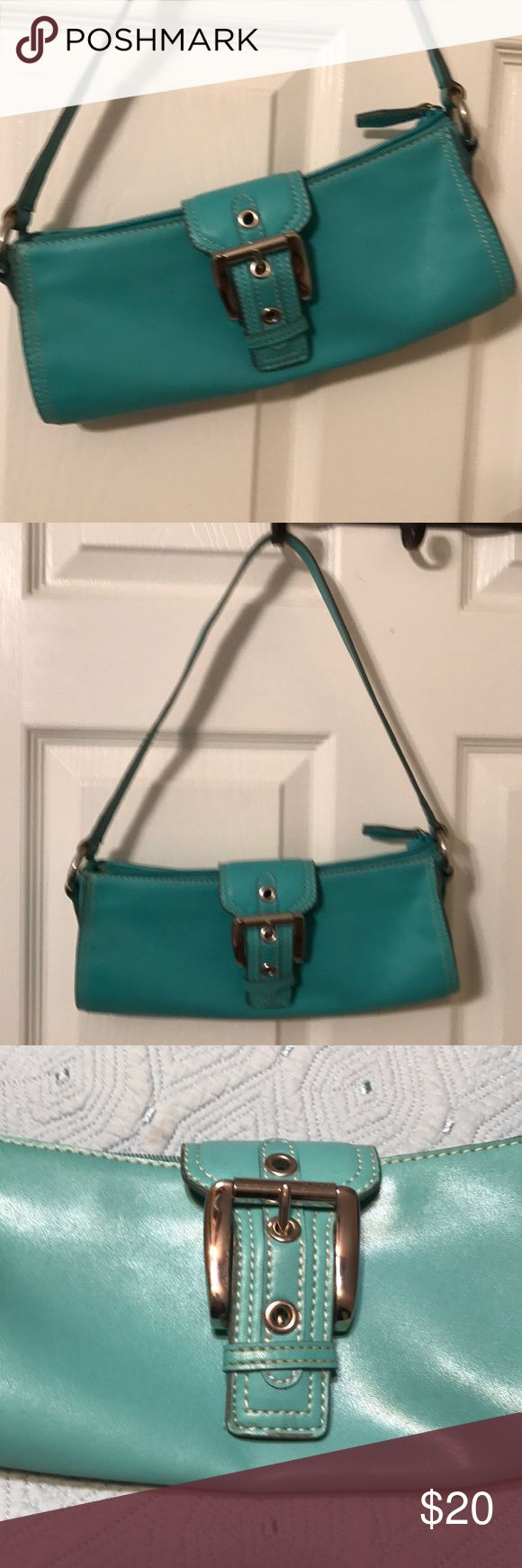 Turquoise  purse. Turquoise with a cute silver buckle clasp purse. Hardly been used. 11 inches wide and 5 inches from zippered to bottom first rap is 21 inches in the half long. Very cute casual purse or. Dress up nine west Other