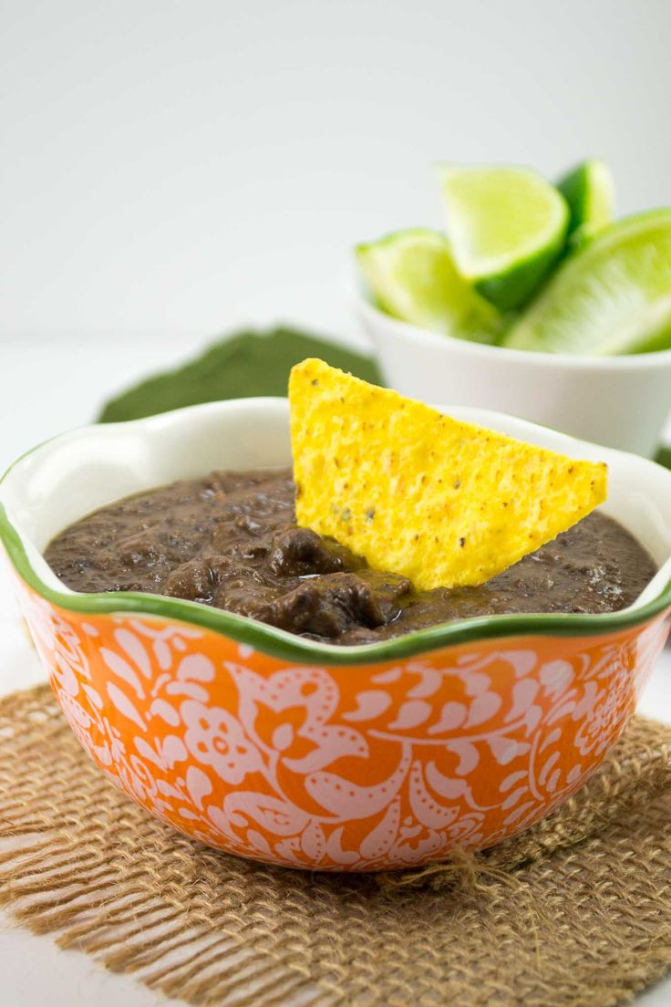 5 minute homemade refried beans - use canned black beans and just a few spices to make a quick and delicious addition to dinner!