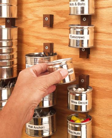 Screw wood clips to plywood and put cans to work.  Recycled cans make great hardware holders