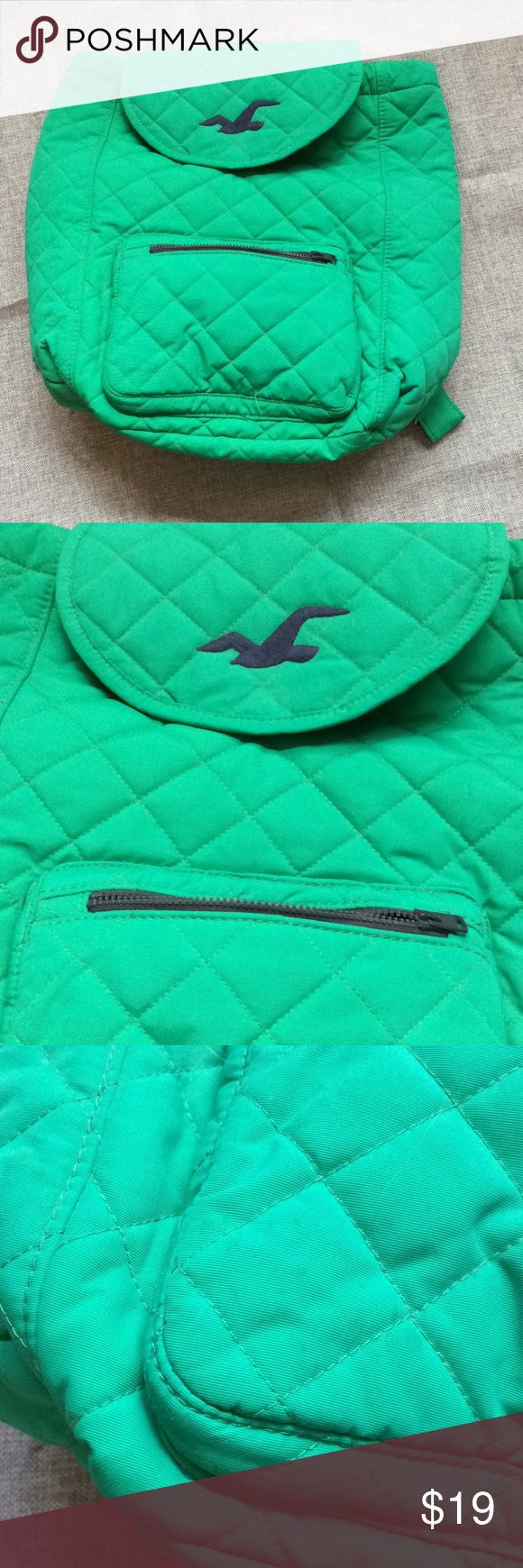 Hollister Green Backpack Bag w/Blue Symbol Hollister Green Backpack with Blue interior! Soft and easy to fold away! Used twice with only small marks on the left front (as seen on picture attached) . Good condition! Length: 16 inches Buy in a bundle and save! Hollister Bags Backpacks