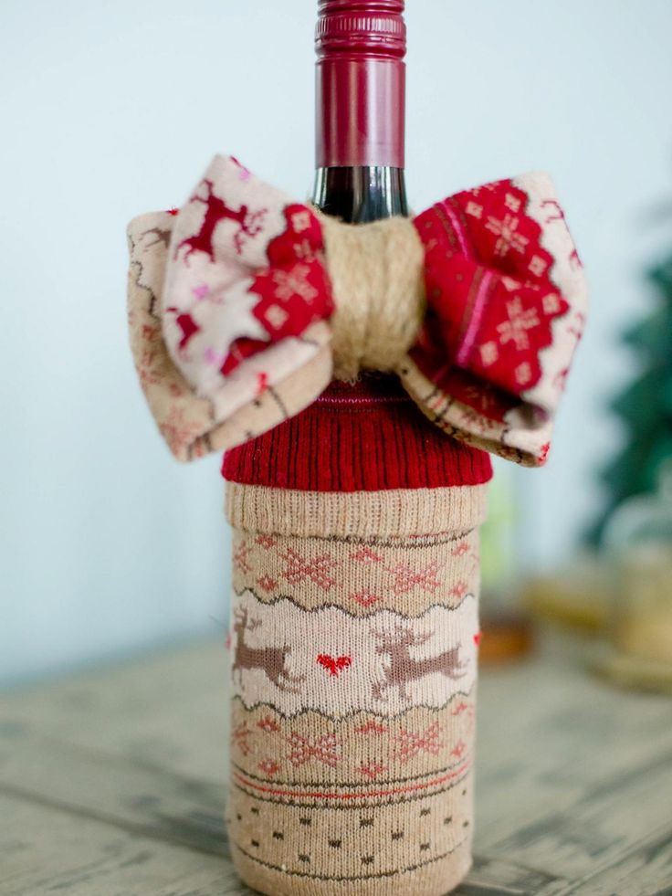 Cute Way to Dress Up A Wine Bottle! Throw it in a Christmas Sock! Kind of like Inviting your wine bottle to an ugly christmas sweater party.
