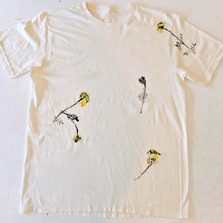 What are you wearing for Election Day? Fresh Printed Marigolds by artist-printmaker-designer Janis Stemmermann #janisstemmermann This Victory Garden silk screen printed t-shirt can be purchased individually or as part as limited edition collectors portfolio. Go to http://www.russelljanis.com/shop/victory-garden-tshirt-portfolio/ to see entire print portfolio project and to purchase.