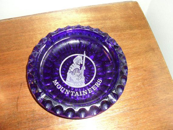 Someone should buy this Fenton glass ashtray from Etsy.  I would definitely want this if I was a smoker! Fenton Mountaineers Ashtray by TheBunnyHutch on Etsy, $19.99