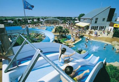 Tropical pool complex with waterslides and chutes...keeping the Kids happy...and cool!