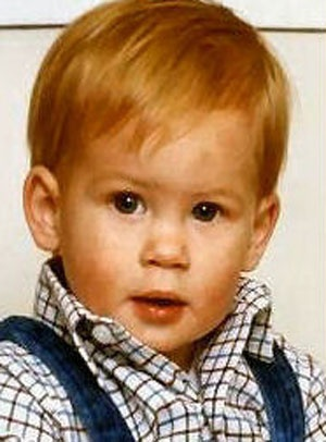 Prince Harry.  He looks so much like his mother here....how sweet.