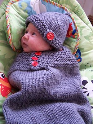 Knitted baby cozy and hat