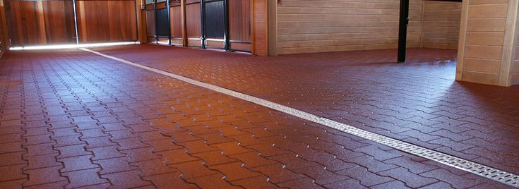 Our equine rubber flooring includes interlocking rubber pavers for barn aisles, rubber mats or tiles for horse stalls and seamless rubber flooring