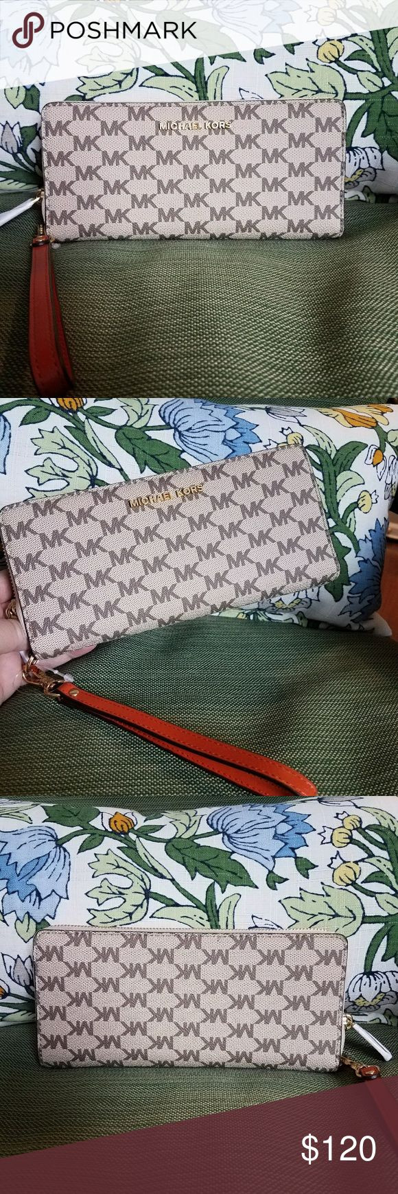 Nwt Michael Kors Jet Set Travel Continental large Nwt Michael Kors Jet Set Travel Continental large wallet in tan signature print and orange wrist strap and interior. Comes with all original packaging as pictured. Michael Kors Bags Wallets