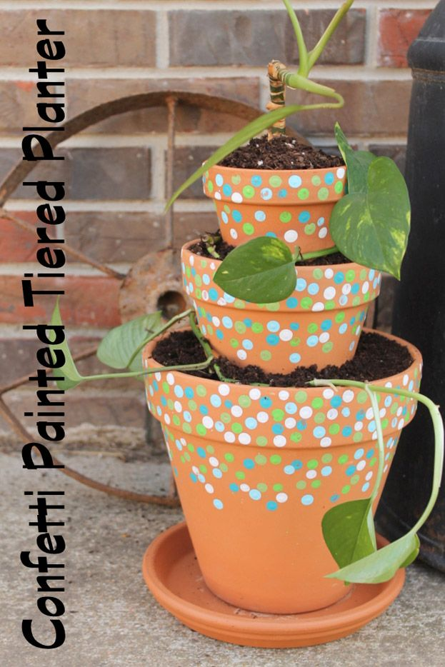 Learn how to make and paint this fun confetti painted tiered planter from standard terra cotta pots.  Get all sizes of terra cotta pots at Old Time Pottery.  Grab three sizes that work well together and get started on this super easy project for your outdoor décor this summer.