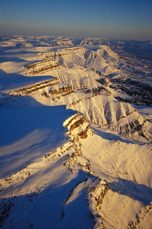 Aerial Of Snow Covered Cliffs, Nahanni National Park, Northwest Territories, Canada.  Photo: Nick Norman