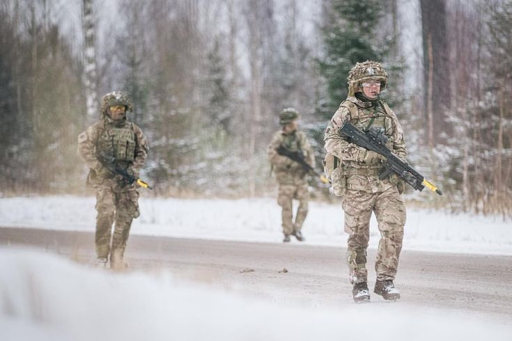 Soldiers from The Royal Welsh patrolling in Estonia. The troops, who are the lead element in the NATO enhanced Forward Presence Battlegroup, set up camp in woods on the snowy Central Training Area in Tapa. #efp #deployed #troops #army #green #snow#cold #battlegroup #NATO #Estonia #protection#force #team #soldier
