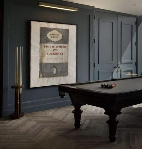 Monochromatic - the walls. the slate blue pool table. the chevron floors. the penguin poster!