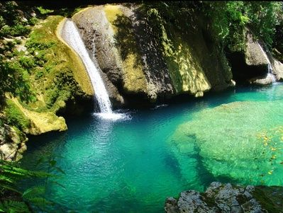Port Antonio boasts secluded lagoons, hidden waterfalls, the secluded Frenchman's Cove Beach and the scenic Rio Grande Valle