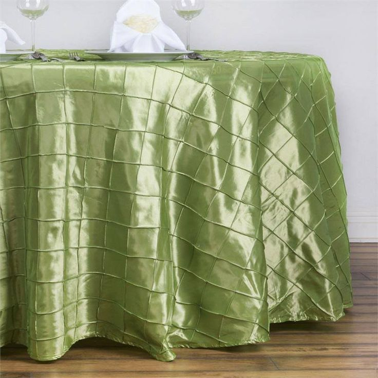 """Apple Green Pintuck Tablecloths 132"""" Round - Pintuck is actually a fold of fabric that is stitched intricately to hold it in a place, very much like a pleat. These lovely pleats impart a decorative effect to the fabric by fashioning a visual line at a chosen point. They effortlessly bridge vintage and contemporary styles to create a majestic new classic look. If you do not want your celebration to blend in with other weddings, birthdays, and anniversaries, try our premium quality pintuck…"""