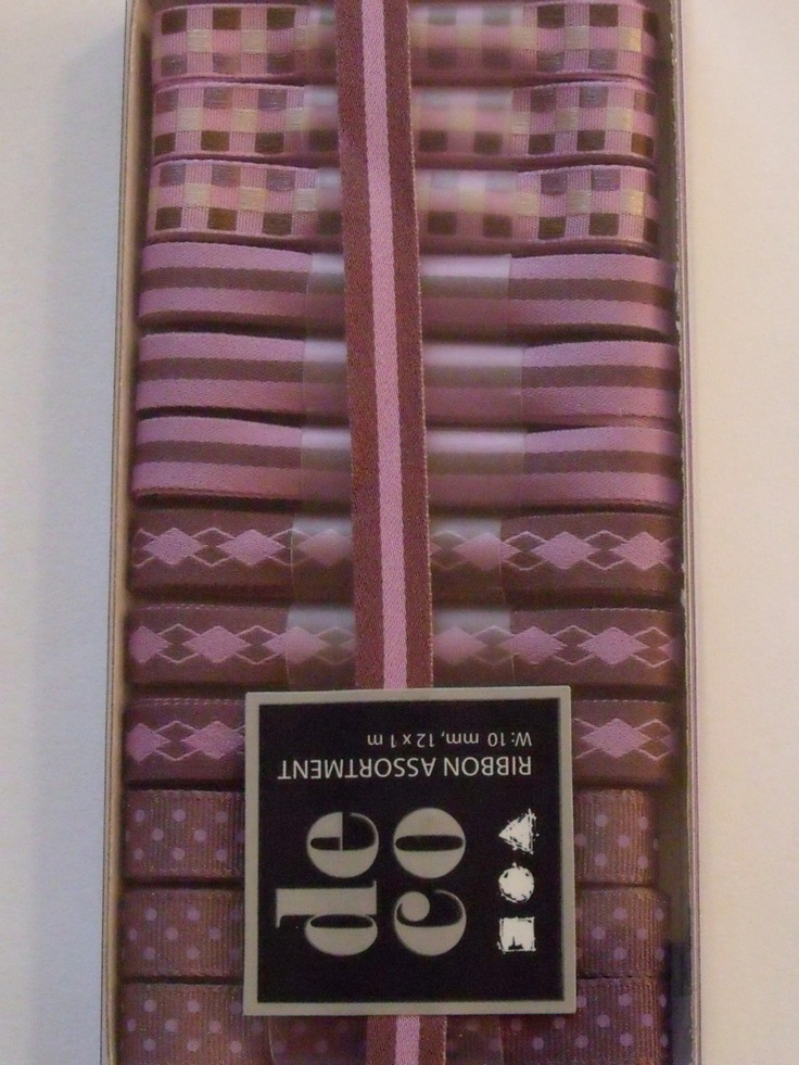 WOODWARE RIBBON COLLECTION - SHADES OF PURPLE -      Box of shades of purple coloured ribbons with 12 m of ribbon in 1m lengths. 3 of each of the 4 designs.