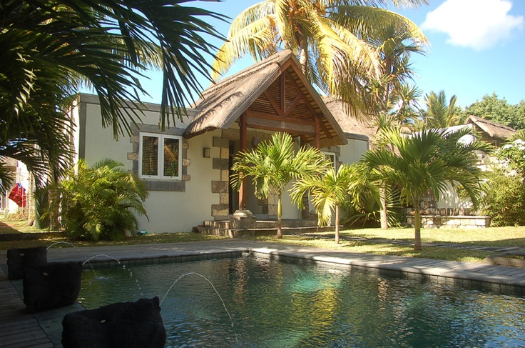 With an idyllic view over the crystal waters of the Indian Ocean, this private beach villa offers a permanent invitation to even the most discerning spirit. Ideal for honeymooners/families, this private sanctuary invites to relaxation. The spacious property boasts 4 large bedrooms and sleeps up to 6 adults and 3 children. #Mauritius #Villas #Beach #Pool #Coconut I ❤ MAURITIUS! ツ…