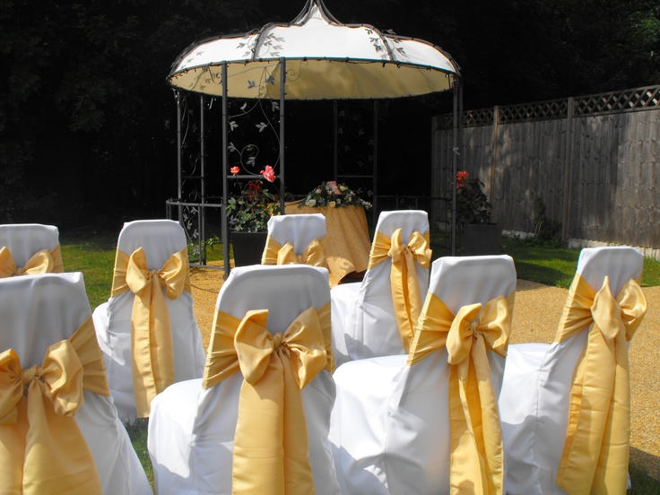 Matt Gold Satin Bows on White Chair Covers