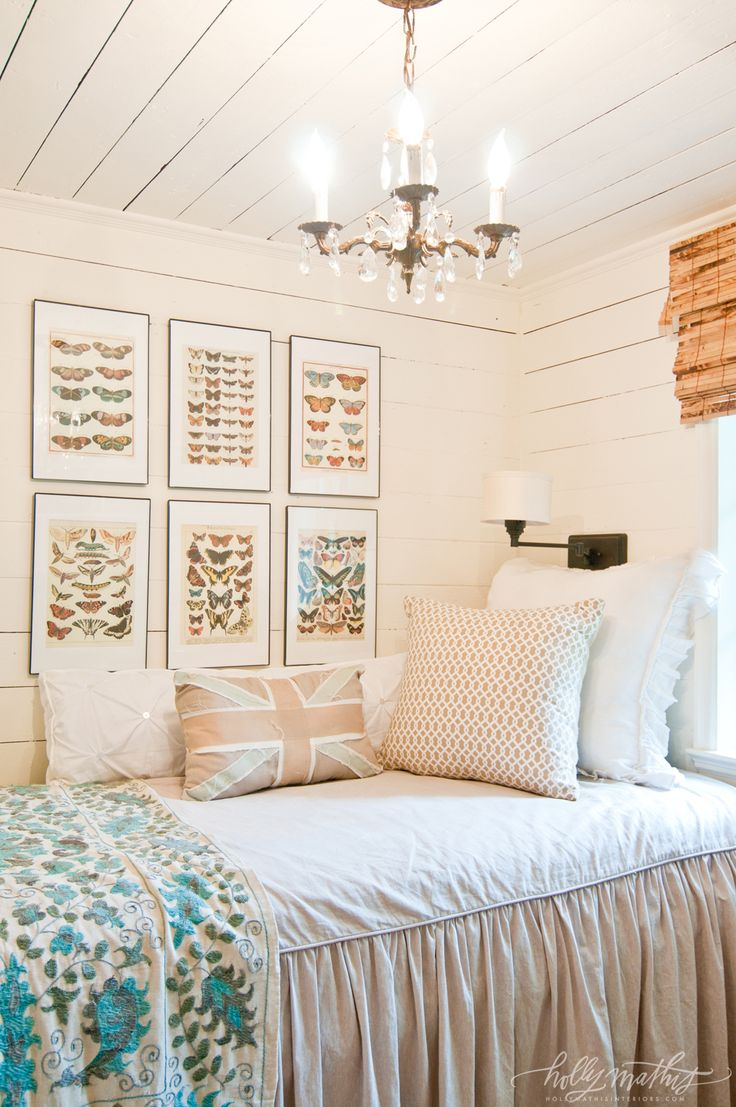 Tiny upstairs guest room. Photography by Natalie Lacy Lange. love the butterfly pictures