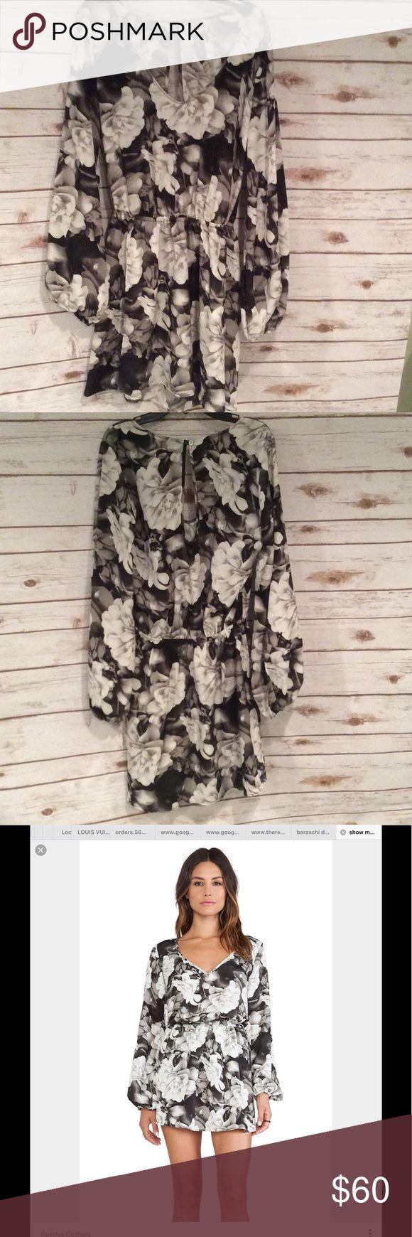 Show Me Your Mumu Rainey Floral Mini Dress Worn just once. Show me your Mumu Rainey. I I Floral dress in Blossom Bling.  Size Medium.  Elastic waist. Button hole cut out in back.  Polyester Show Me Your MuMu Dresses Mini