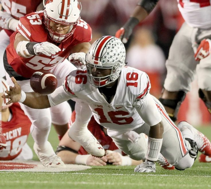 Ohio State Buckeyes quarterback J.T. Barrett (16) recovers his own fumble against Wisconsin Badgers linebacker T.J. Edwards (53) in the first quarter,