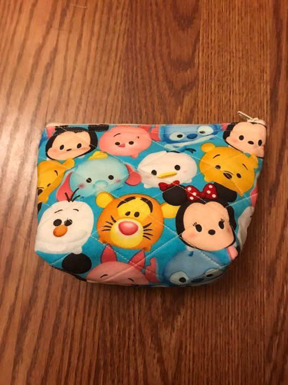 154f52c90835 Minnie Mouse · This bag features many of your favorite Disney Tsum Tsum  characters. The background is a