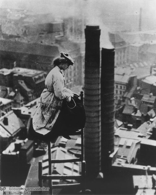 A Female Mason Perched High above Berlin (c. 1910) With the rise of industrialization, the number of German women who worked outside the home also increased. This usually meant factory work. But in some families with their own businesses, daughters also learned a trade so that they could help out: here, we see a master-mason's daughter during the renovation work on the old city hall tower in Berlin. via GHDI