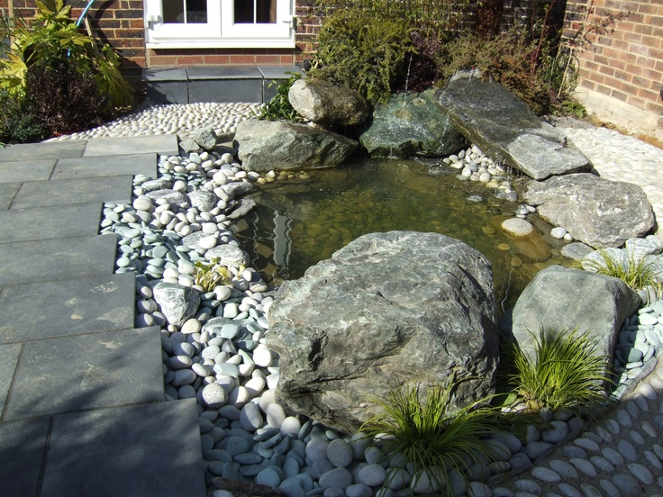 Striking Japanese Pond And Waterfall With Rock Seats And