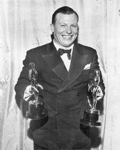 Harold Russell holds his two Oscars. Best supporting actor for The Best Years of Our Lives, which is a real gem of a movie, about three WWII vets relearning life at home among civilians....