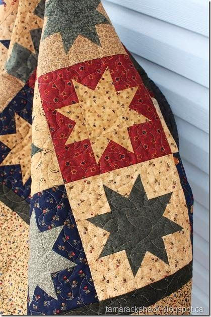 Star Fling Quilt ◆ The panto used on this one is called Wildflower and looks nice with all the tiny floral prints in the fabrics. A light brown So Fine thread and Quilters Dream Blend batting was used.