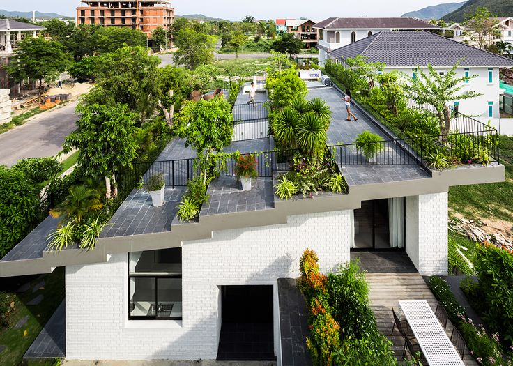 A large tiered garden forms the roof of this house in the coastal Vietnamese city Nha Trang