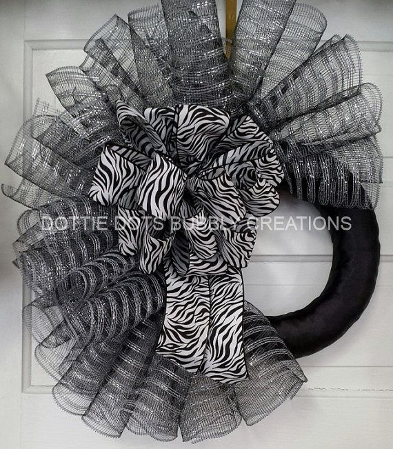 Silver Black Striped Spiral Mesh Wreath. But I would do the entire wreath and not leave the space.