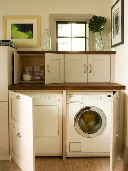 Instead of using bifold doors to block off the laundry room, turn it into usable space by adding wide cabinet doors and putting a finished countertop above. Obviously works best with front-load W/D, but could be adapted to a top-load washer with up-swinging hinges in the countertop. When not doing laundry, the refurbished space serves as a buffet or additional counter space.