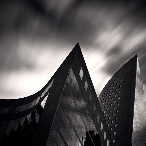 extreme angles of view, simple clean lines. I intend to experiment with black and white settings on my camera as well as the colour. This photograph has inspired me to photograph sections of buildings at extreme angles