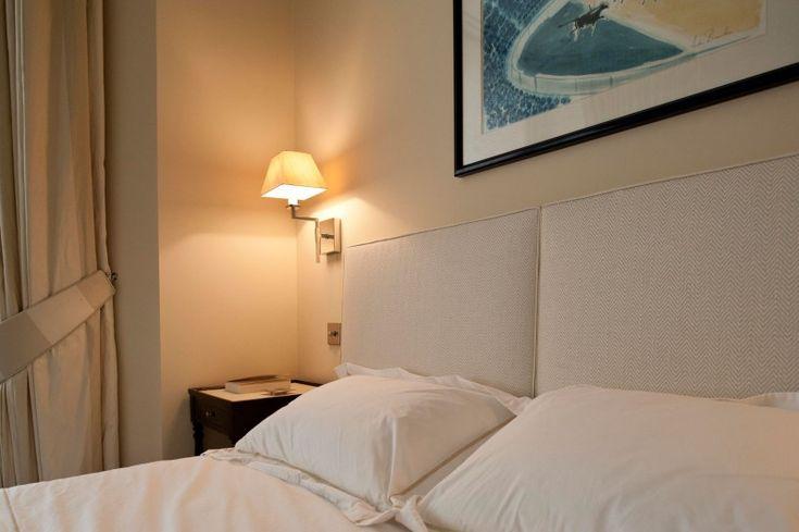 White Duvet Cover and Cream Upholstered Headboard at Gardens House