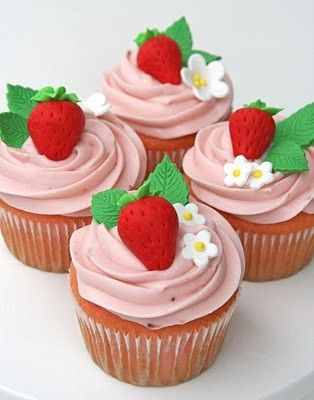I love these cute little strawberries! Gumpaste? Fondant? Modeling chocolate? Hmm ...