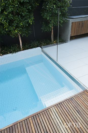 OFTB Melbourne landscaping, pool design & construction project - plunge pool inc water wall, timber pool deck, custom curved glass frameless...