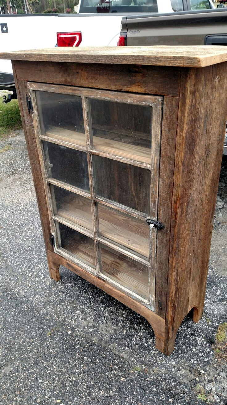 Barnwood heart pine cabinet with old window as the door