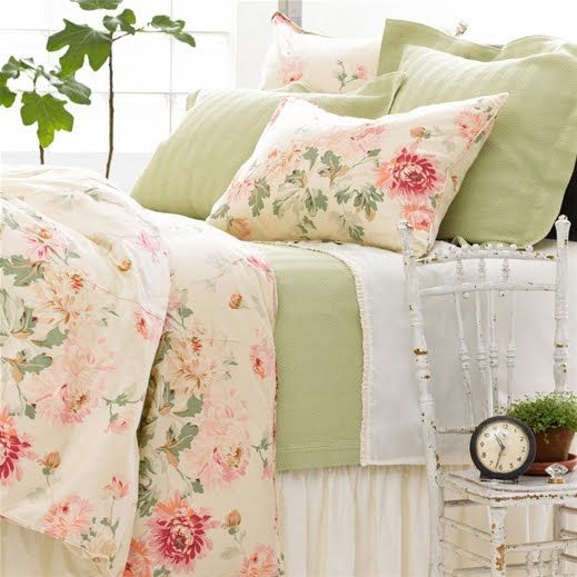 Lovely country florals and pale green bedding.