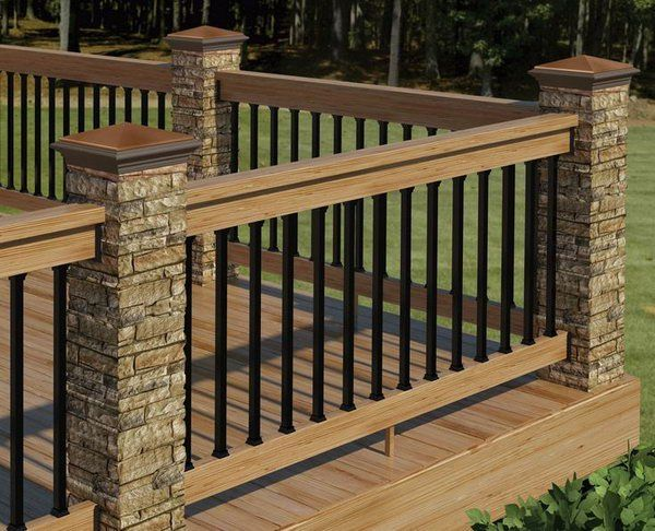 Stone, metal and wood deck railing. This deck railing has a wooden top with horizontal metal rails and big stone pillars and it's very sturdy and low maintenance . The color theme coordinates perfectly with the composite decking. What an attractive, warm and inviting outdoor living space.                                                                                                                                                                                 More