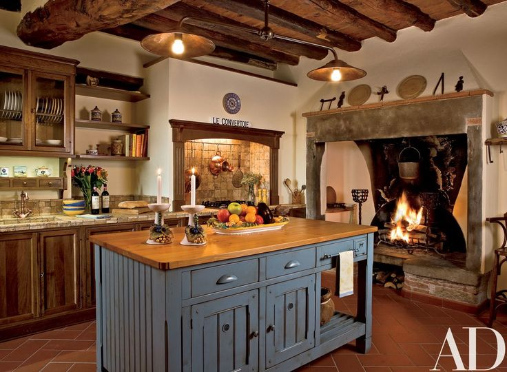 In an Italian fortress turned residence, designer Susan Schuyler Smith installed the center island and cabinetry in the kitchen   archdigest.com