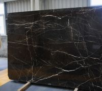 We have one well-known Chinese brown marble that is very similar with the French Nior St. Laurent,please see the technical Attributes as follows: Feature: Brown marble with gold&white stripes;  Compressive Strength: 93.5 MPa;  Bending strength: 16.7 MPa;  Bulk Density 2.69 g/cm3;  Water Absorption: 2.32%;  Using Area:  Suitable for Interior using areas; Shade Variation: Low - Background color is relatively uniform; Available Products: Tiles,Countertops,random slabs or custom products…