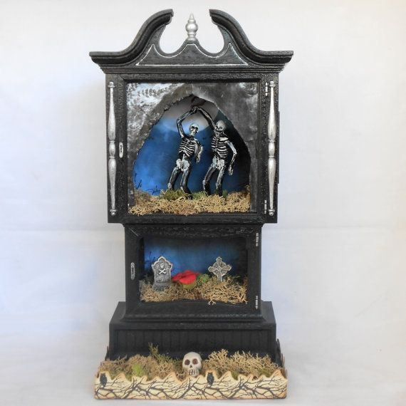 Clock case shadow box Art with skeletons dancing in the graveyard.