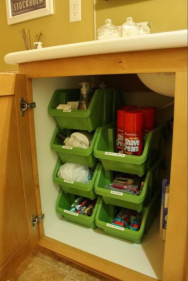 Stacking Plastic Bins Under Bathroom Cabinet. These stacking containers from the Dollar Tree stack vertically very well. You can even clearly see what is in the bins without labeling these organizers.